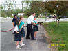 Assistant Chief Wells Assisting Girl Scouts in Training